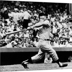 Mickey Mantle of the New York Yankees, hitting his 49th home run of the season–